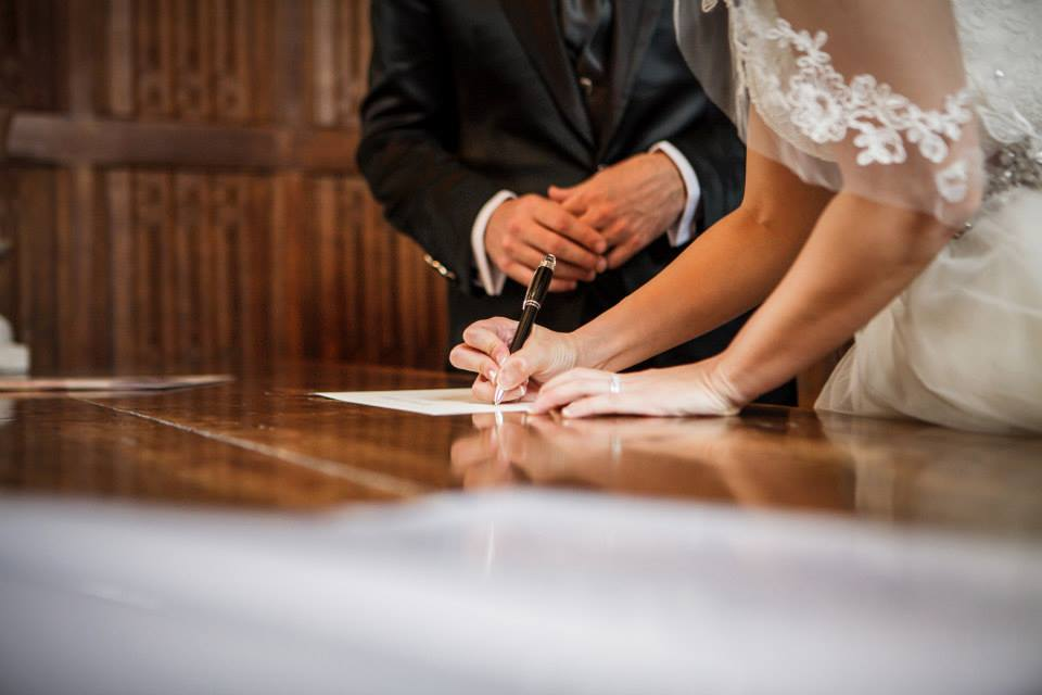 Signing a wedding certificate